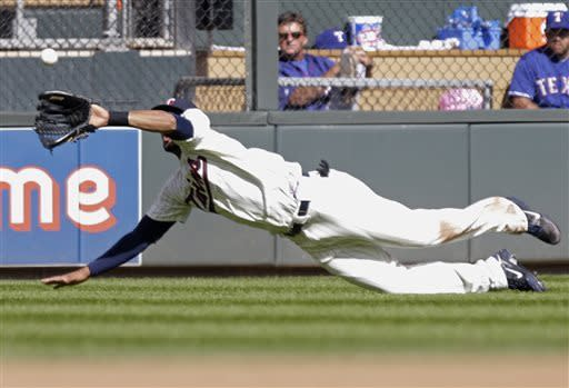 Minnesota Twins center fielder Aaron Hicks fields a shallow pop fly off the bat of Texas Rangers' A.J. Pierzynski in the fourth inning of a baseball game on Saturday, April 27, 2013, in Minneapolis. (AP Photo/Jim Mone)