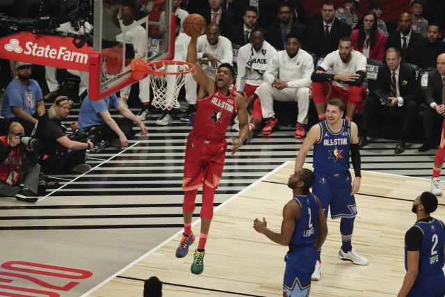 Giannis Antetokounmpo of the Milwaukee Bucks dunks during the first half of the NBA All-Star basketball game Sunday, Feb. 16, 2020, in Chicago. (AP Photo/David Banks)