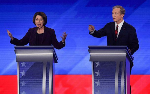 PHOTO: Democratic presidential hopefuls Sen. Amy Klobuchar and billionaire activist Tom Steyer speak during the eighth Democratic primary debate of the 2020 presidential campaign season at St. Anselm College in Manchester, N.H. Feb. 7, 2020. (Timothy A. Clary/AFP via Getty Images)