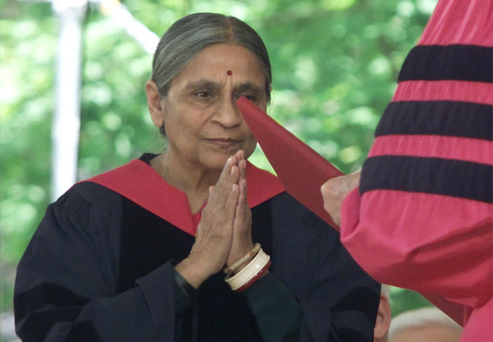 Ela Bhatt, founder of the SEWA Self-Employed Women's Association in Ahmedabad, India, clasps her hands together as she is awarded an honorary Harvard Doctor of Humane Letters Degree, June 7, 2001 during the university's 350th commencement ceremonies in Harvard Yard in Cambridge, Massachusetts. Bhatt organized a traqde union for poor Indian women who make a living by selling vegetables, recycling trash, hand-rolling cigarettes and working at other marginal occupations. (Photo: Reuters)