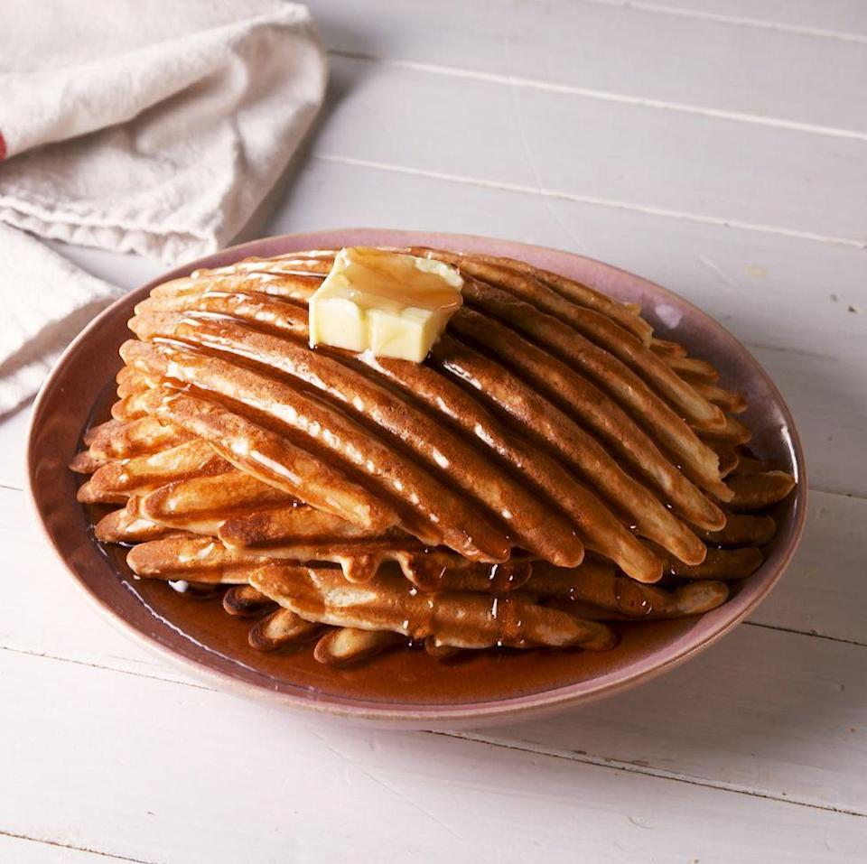 """<p>A griddle pan is the best hack of all time and makes some pretty cool looking waffles. These still cook up perfectly fluffy and have plenty of ridges for holding extra syrup. It's the perfect <a href=""""https://www.delish.com/uk/cooking/recipes/g29930155/healthy-breakfast/"""" rel=""""nofollow noopener"""" target=""""_blank"""" data-ylk=""""slk:breakfast"""" class=""""link rapid-noclick-resp"""">breakfast</a> (or dinner 😉). </p><p>Get the <a href=""""https://www.delish.com/uk/cooking/recipes/a31898714/grill-pan-waffles-recipe/"""" rel=""""nofollow noopener"""" target=""""_blank"""" data-ylk=""""slk:Grill Pan Waffles"""" class=""""link rapid-noclick-resp"""">Grill Pan Waffles</a> recipe.</p>"""
