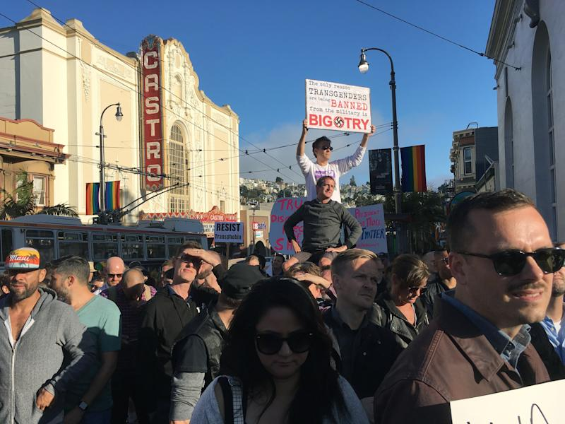 Protesters listen to speakers at a demonstration against a proposed ban of transgendered people in the military in the Castro District, Wednesday, July 26, 2017, in San Francisco. Demonstrators flocked to a plaza named for San Francisco gay-rights icon Harvey Milk to protest President Donald Trump's abrupt ban on transgender troops in the military. (AP Photo/Olga R. Rodriguez)