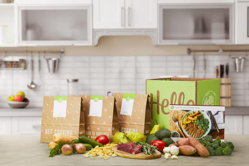 This product display image released by HelloFresh shows ingredients offered from their home delivery meal kits. The growing options for outsourcing meal planning, grocery shopping and cooking can be called time-saving blessings or culture-destroying curses. In the end, they're probably a complicated mix of both. (HelloFresh via AP)