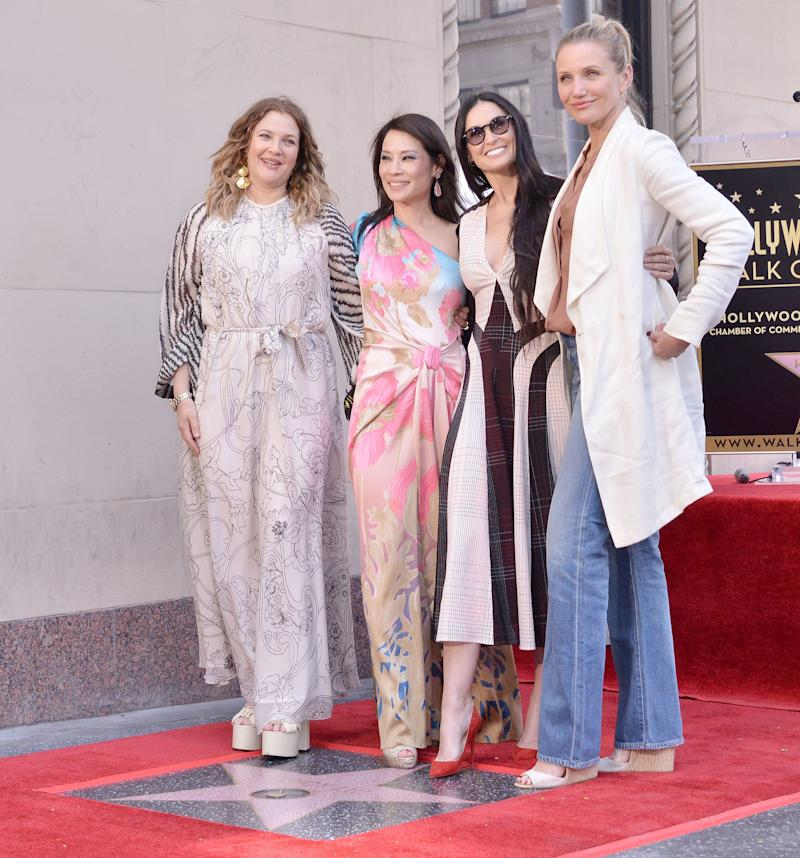 The Charlie's Angels trio posed with former co-star Demi Moore. [Photo: PA]