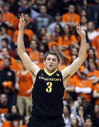 Oregon guard Garrett Sim (3) celebrates after hitting a 3-pointer in the first half of an NCAA college basketball game with Oregon State, Sunday, Feb. 26, 2012, in Corvallis, Ore. (AP Photo/Rick Bowmer)