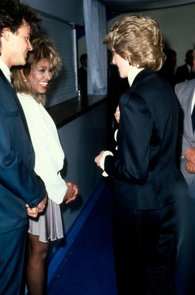 <p>Tina Turner wore a spandex dress and a white oversized jacket when she met Princess Diana backstage at the Prince's Trust concert in Wembley Stadium. </p>