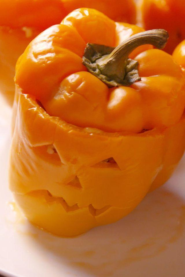 """<p>This recipe calls for you to stuff these peppers with rice, cheese, and ground beef, but you can personalize it with whatever ingredients you prefer. </p><p><em><strong>Get the recipe at <a href=""""https://www.delish.com/cooking/recipe-ideas/recipes/a49656/jack-o-lantern-stuffed-peppers-recipe/"""" rel=""""nofollow noopener"""" target=""""_blank"""" data-ylk=""""slk:Delish"""" class=""""link rapid-noclick-resp"""">Delish</a>.</strong></em></p>"""