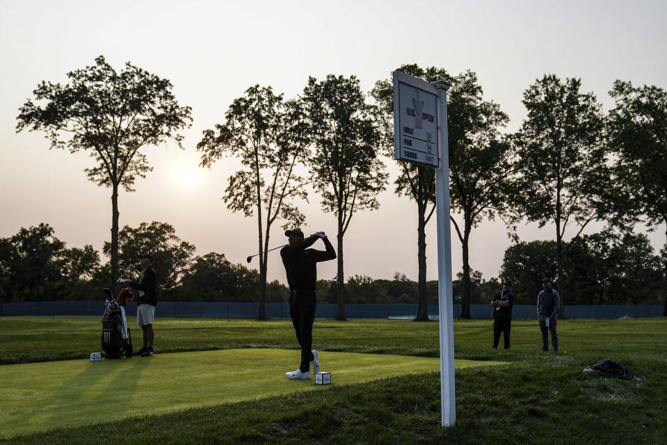 Tiger Woods watches his shot off the fourth tee during practice before the U.S. Open Championship golf tournament at Winged Foot Golf Club, Wednesday, Sept. 16, 2020, in Mamaroneck, N.Y. (AP Photo/John Minchillo)