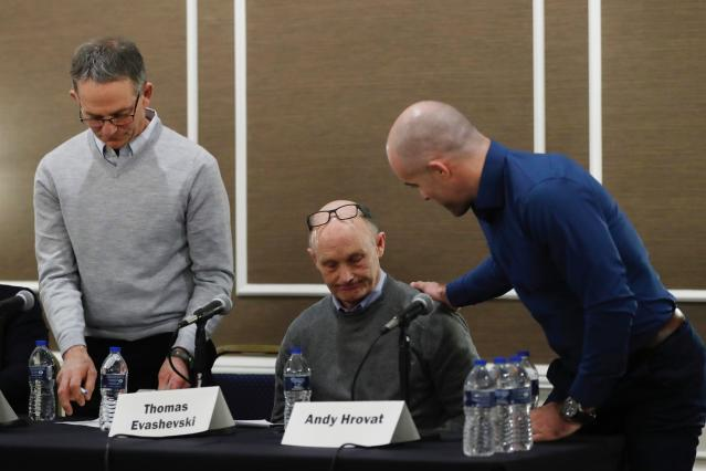 Andy Hrovat, right, talks with Thomas Evashevski after a news conference, Thursday, Feb. 27, 2020 in Southfield, Mich. Hrovat, Evashevski and Tad Deluca, left, are three of the University of Michigan wrestlers who say they were abused by a sports doctor. (AP Photo/Carlos Osorio)