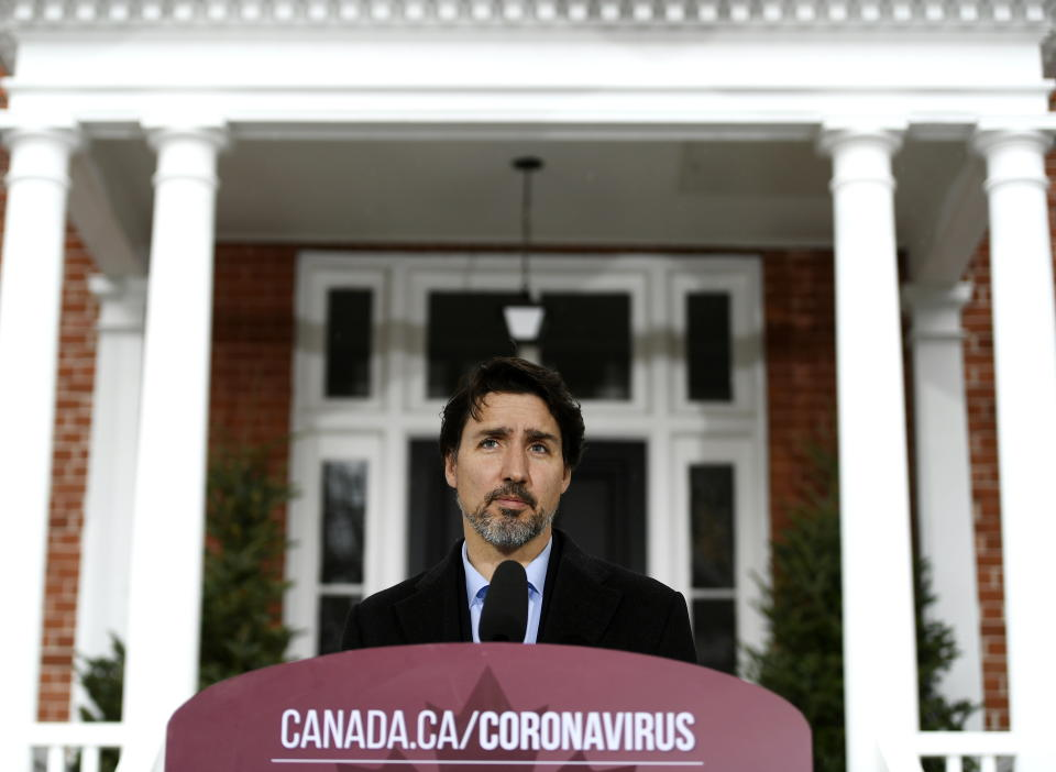 Prime Minister Justin Trudeau speaks during his daily press conference on COVID-19 and coronavirus in front of his residence at Rideau Cottage in Ottawa, on Sunday, April 19, 2020. (Justin Tang/The Canadian Press via AP)