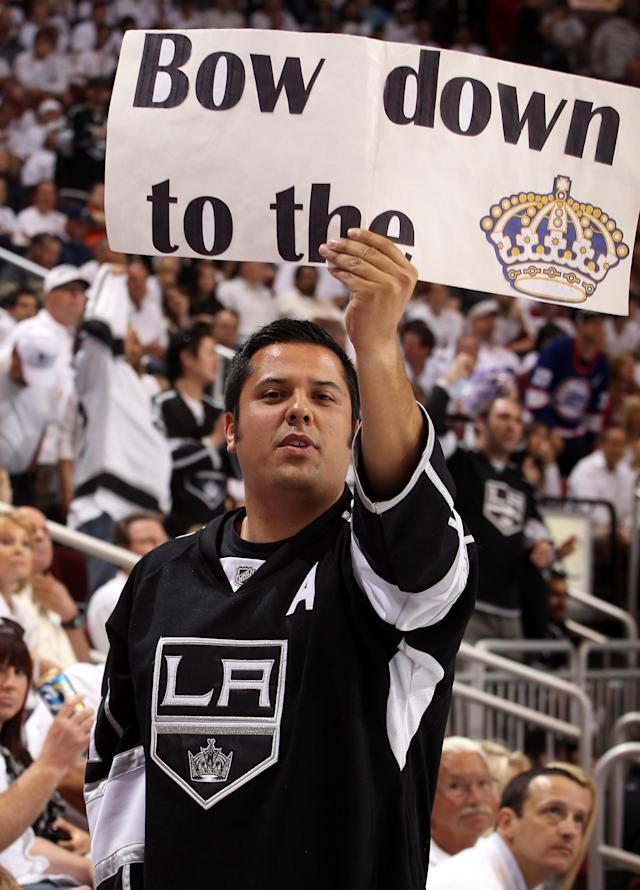 GLENDALE, AZ - MAY 22: A Los Angeles Kings fan holds up a sign in the second period in Game Five of the Western Conference Final during the 2012 NHL Stanley Cup Playoffs against the Phoenix Coyotes at Jobing.com Arena on May 22, 2012 in Phoenix, Arizona. (Photo by Christian Petersen/Getty Images)