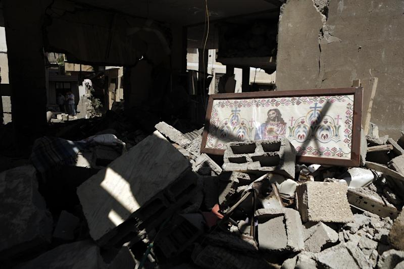An image of Jesus Christ rests on the rubble of the home of Jalila Ayyad, a Christian woman killed following an Israeli airstike on her home in Gaza City on July 27, 2014