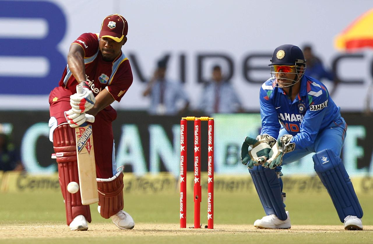 West Indian cricketer Johnson Charles in action during the 1st ODI match between India and West Indies at Nehru Stadium in Kochi on Nov.21, 2013. (Photo: IANS)