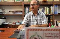 The seminary has a large collection of old Islamic manuscripts that historian Fathi al-Zirkhani is eager to preserve for posterity