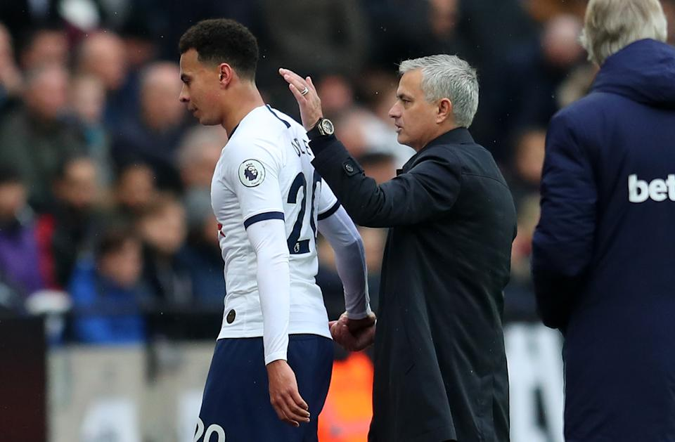 LONDON, ENGLAND - NOVEMBER 23: Jose Mourinho, Manager of Tottenham Hotspur embraces Dele Alli of Tottenham Hotspur during the Premier League match between West Ham United and Tottenham Hotspur at London Stadium on November 23, 2019 in London, United Kingdom. (Photo by Catherine Ivill/Getty Images)