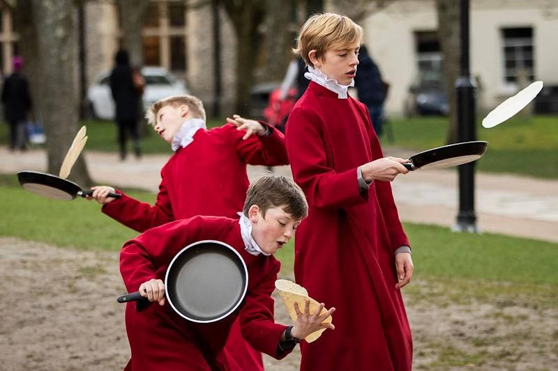 WINCHESTER, ENGLAND - MARCH 05: Choristers from Winchester Cathedral joke around in between being posed up for pictures by photographers on March 5, 2019 in Winchester, England. Winchester Cathedral held it's inaugural Shrove Tuesday Pancake day race in the Cathedral grounds today with money raised going to local charities. (Photo by Dan Kitwood/Getty Images)