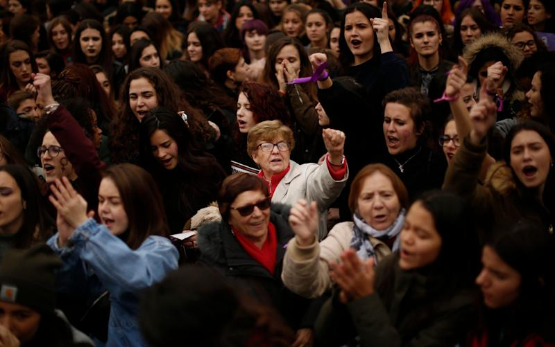 Women shout slogans during a protest at the Sol square during the International Women's Day in Madrid, Thursday, March 8 - AP