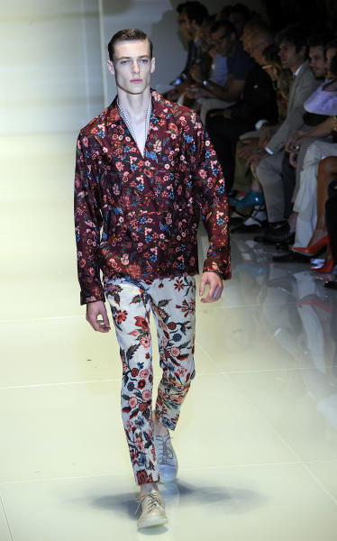 A model wears a creation for Gucci men's Spring-Summer 2014 collection, part of the Milan Fashion Week, unveiled in Milan, Italy, Monday, June 24, 2013. (AP Photo/Giuseppe Aresu)