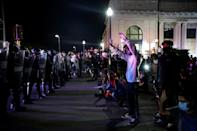 Protesters face off with police outside the County Courthouse during demonstrations against the shooting of Jacob Blake in Kenosha, Wisconsin