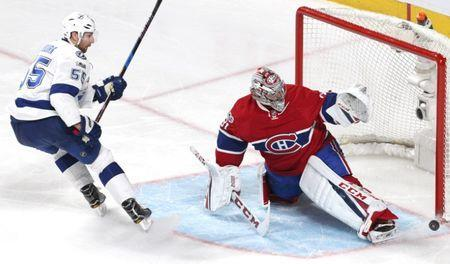 Apr 7, 2017; Montreal, Quebec, CAN; Montreal Canadiens goalie Carey Price (31) makes a save against Tampa Bay Lightning defenseman Braydon Coburn (55) during the third period at Bell Centre. Mandatory Credit: Jean-Yves Ahern-USA TODAY Sports