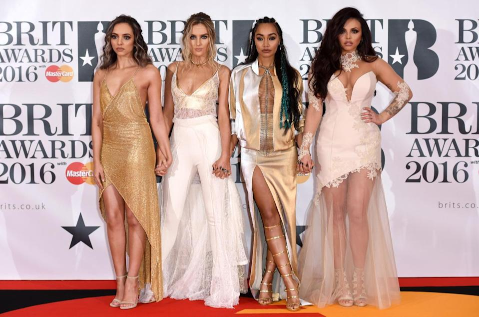 <p>The foursome managed to steal the show (yet again) in an array of lace, metallics and semi-sheer looks. <i>[Photo: Rex]</i></p>