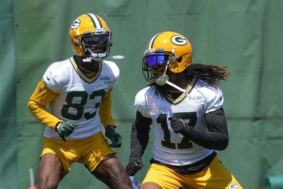 Green Bay Packers' Davante Adams and Marquez Valdes-Scantling run a drill during an NFL football minicamp Tuesday, June 8, 2021, in Green Bay, Wis. (AP Photo/Morry Gash)