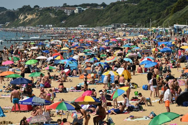 Britain was hit by a flood of visitors during a heatwave last week (AFP Photo/Glyn KIRK)
