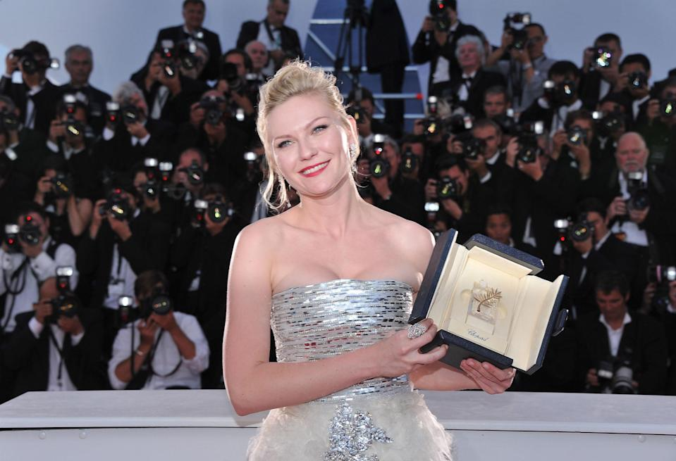 Kirsten Dunst with her best-actress award at the 64th Cannes Film Festival in 2011