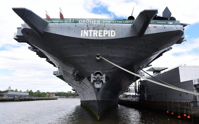 The USS Intrepid, a decommissioned World War II aircraft-carrier now the Intrepid Sea, Air and Space Museum, is berthed on the Hudson River - Credit: AFP