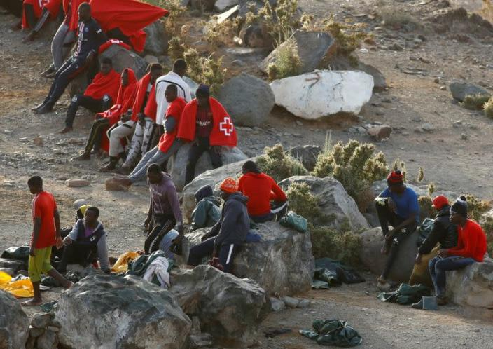 Group of immigrants is pictured at Las Carpinteras beach on the island of Gran Canaria