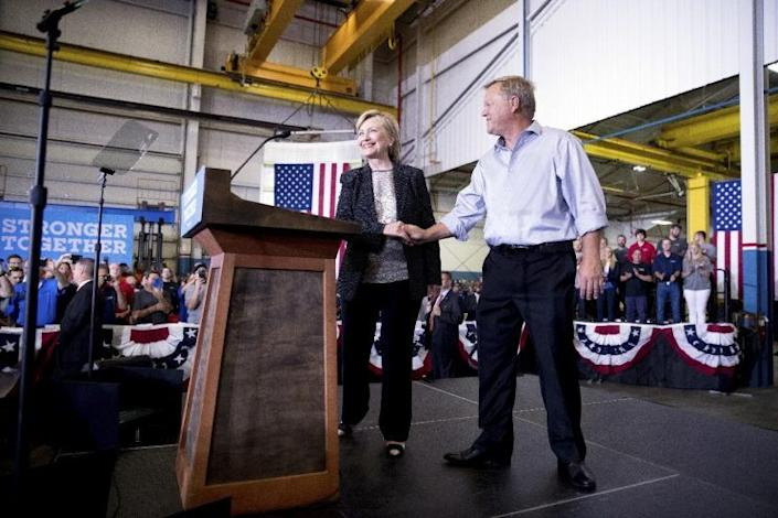 Hillary Clinton is welcomed to the stage after touring Futuramic Tool & Engineering, in Warren, Mich. (Photo: Andrew Harnik/AP)