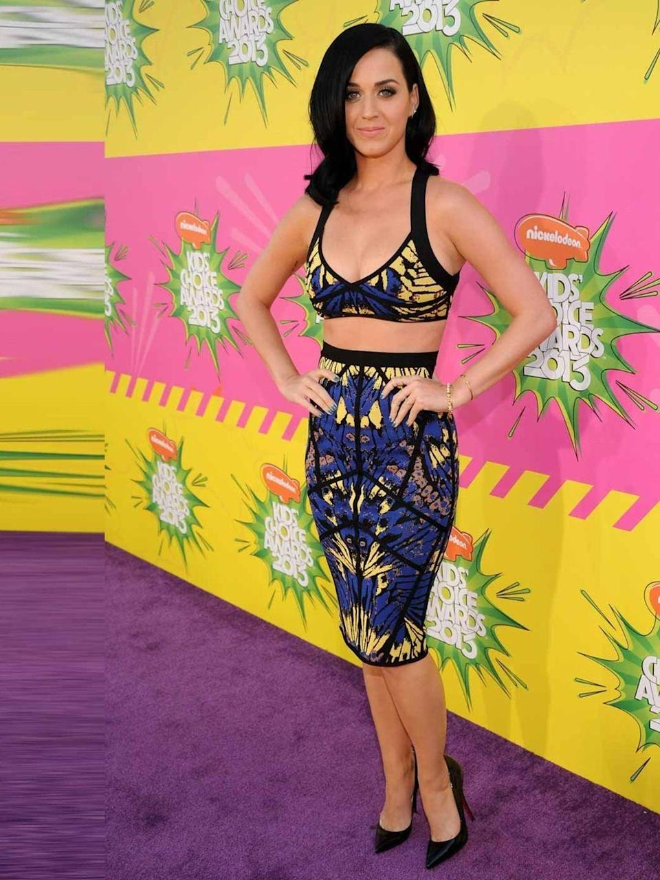 <p>Katy Perry wears Hervé Léger with Christian Louboutin shoes .</p>