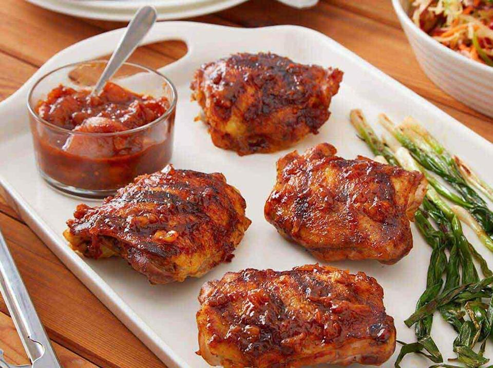 """<p>Bringing together the <a href=""""https://www.thedailymeal.com/cook/classic-southern-recipes-are-better-grandma-s-gallery?referrer=yahoo&category=beauty_food&include_utm=1&utm_medium=referral&utm_source=yahoo&utm_campaign=feed"""" rel=""""nofollow noopener"""" target=""""_blank"""" data-ylk=""""slk:best of Southern cuisine"""" class=""""link rapid-noclick-resp"""">best of Southern cuisine</a>, this grilled chicken recipe brines the bird in sweet tea and uses a barbecue sauce made with fresh peaches.</p> <p><a href=""""https://www.thedailymeal.com/best-recipes/sweet-tea-brined-grilled-chicken-thighs-peach-bbq-sauce?referrer=yahoo&category=beauty_food&include_utm=1&utm_medium=referral&utm_source=yahoo&utm_campaign=feed"""" rel=""""nofollow noopener"""" target=""""_blank"""" data-ylk=""""slk:For the Sweet Tea Brined Grilled Chicken With Peach BBQ Sauce recipe, click here."""" class=""""link rapid-noclick-resp"""">For the Sweet Tea Brined Grilled Chicken With Peach BBQ Sauce recipe, click here.</a></p>"""
