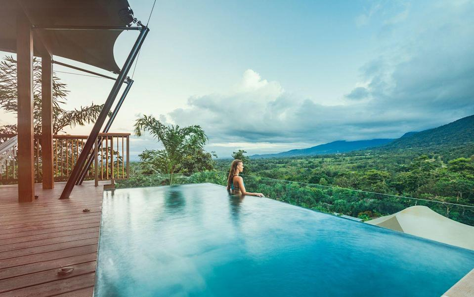 """<p>This offshoot of the Nayara Springs resort has 19 1,700-square-foot luxe tents modeled on the glamorous, multi-room creations of high-end African safari companies. (Some are linkable--ideal for families.) Each sits on its own platform, has a plunge pool fed by nearby hot springs, and stunning views of Arenal Volcano. This area has become a magnet for the active--you can horseback ride, hike, kayak, canoe, zip line, mountain bike, white-water raft, and take canopy or ATV tours. Or do nothing at all. Hours-long soaks in the aforementioned hot pools are always on the menu, and the spa has breezy, open-sided treatment rooms looking out over the surrounding rainforest.</p><p><a class=""""link rapid-noclick-resp"""" href=""""https://nayaratentedcamp.com/"""" rel=""""nofollow noopener"""" target=""""_blank"""" data-ylk=""""slk:Book Now"""">Book Now</a></p>"""