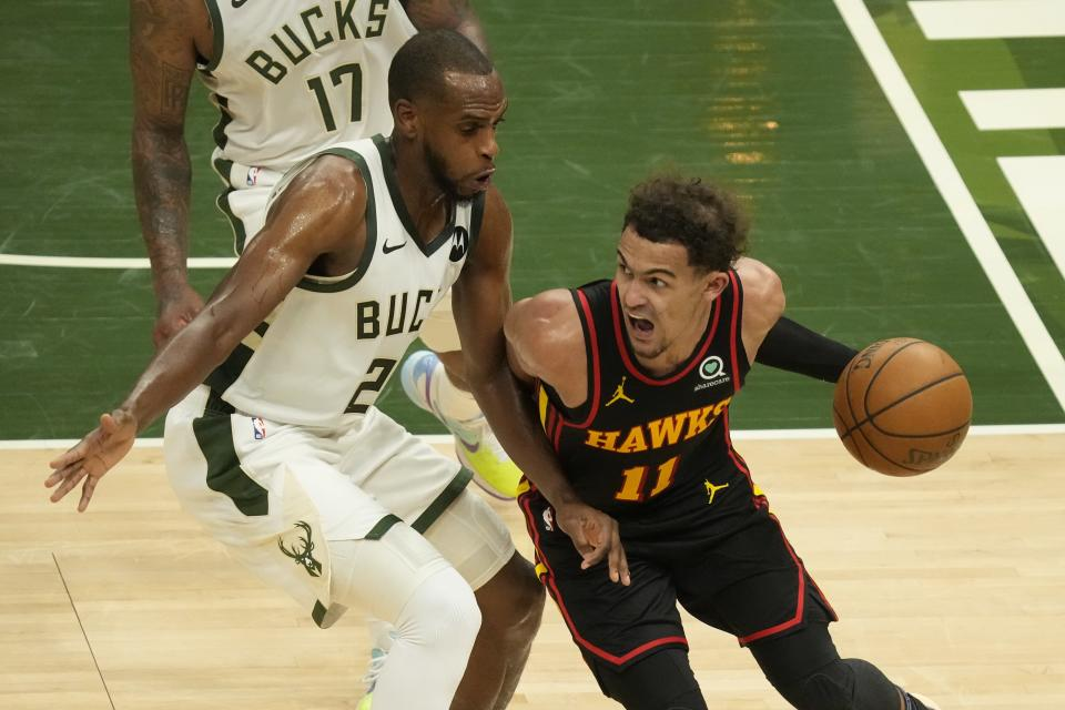 Atlanta Hawks' Trae Young tries to drive past Milwaukee Bucks' Khris Middleton during the second half of Game 2 of the NBA Eastern Conference basketball finals game Friday, June 25, 2021, in Milwaukee. (AP Photo/Morry Gash)