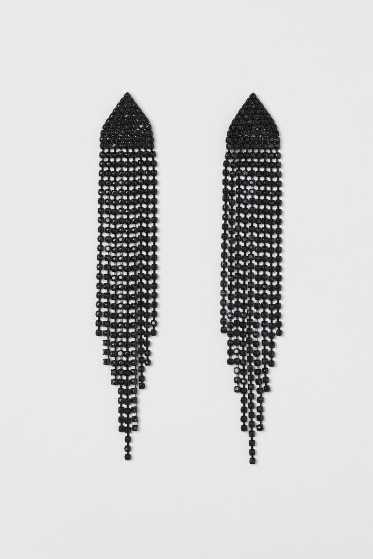 <p>A kiss on the hand may be quite continental, but <span>Long Rhinestone Earrings</span> ($13) might be Moira's best friend. </p>