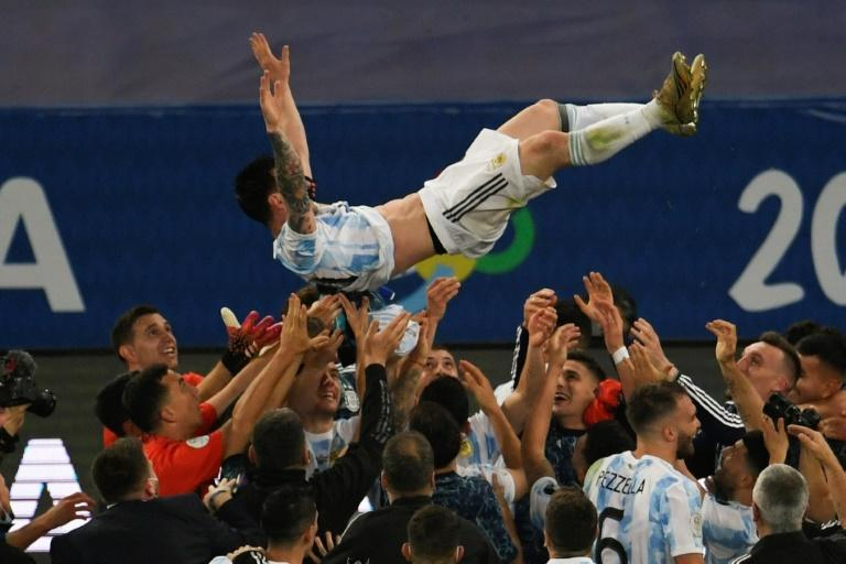 Argentina's Lionel Messi is thrown into the air by celebrating teammates after winning the 2021 Copa America