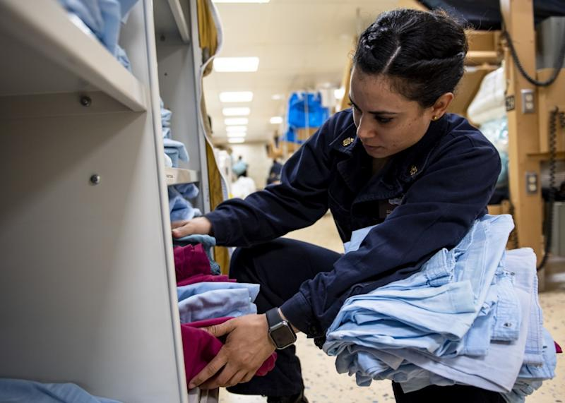 Chief Hospital Corpsman Dom Navarro, from Orange County, Calif., counts patient gowns in the medical ward aboard hospital ship USNS Mercy (U.S. Navy photo by Mass Communication Specialist 2nd Class Ryan M. Breeden)
