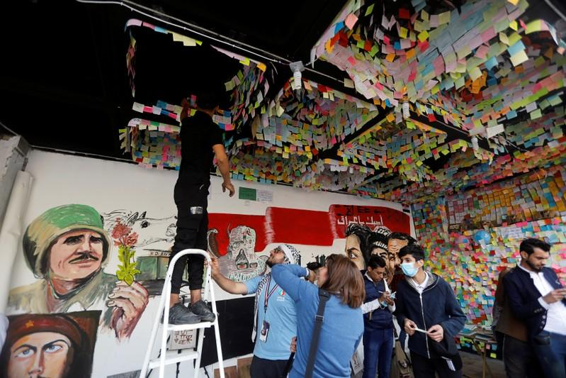 Iraqi demonstrators gather to paste their wishes at a wall of wishes, during ongoing anti-government protests, at the building called 'the Turkish Restaurant Building', in Baghdad