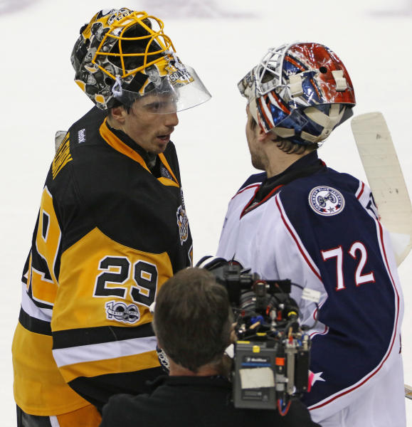 Pittsburgh Penguins goalie Marc-Andre Fleury (29) shakes hands with Columbus Blue Jackets goalie Sergei Bobrovsky (72) after a 5-2 Penguins win in Game 5 of an NHL first-round hockey playoff series in Pittsburgh, Thursday, April 20, 2017. The Penguins won the series. (AP Photo/Gene J. Puskar)