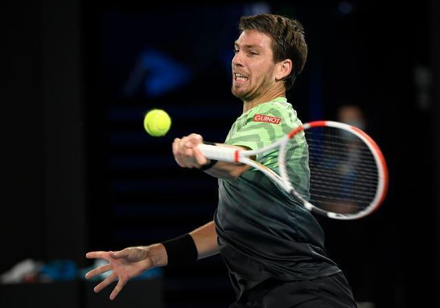 Cameron Norrie plays a forehand during his loss to Rafael Nadal