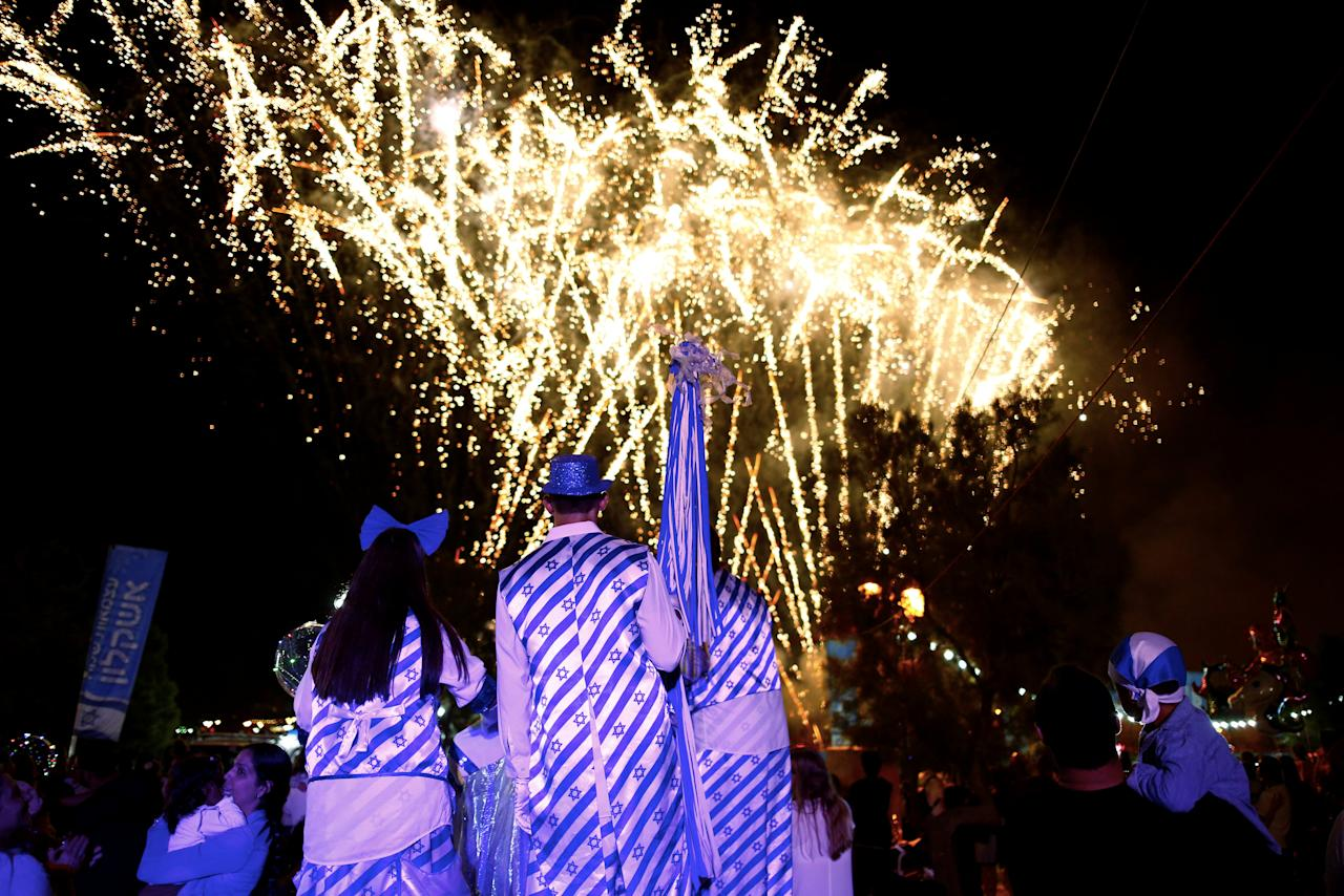 Israelis watch a fireworks show during celebrations marking Israel's 70th Independence Day in the southern city of Ashkelon, Israel April 18, 2018. REUTERS/Amir Cohen