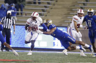 SMU running back Ulysses Bentley IV (26) is grabbed by Tulsa linebacker Zaven Collins (23) during the second half of an NCAA college football game in Tulsa, Okla., Saturday, Nov. 14, 2020. (AP Photo/Joey Johnson)
