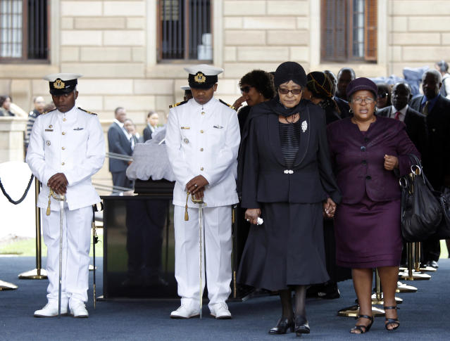 <p>Winnie Mandela, second from right, ex-wife of former South African President Nelson Mandela, views his coffin as he lies in state at the Union Buildings in Pretoria, Dec. 11, 2013. (Photo: Kim Ludbrook/Pool/Reuters) </p>