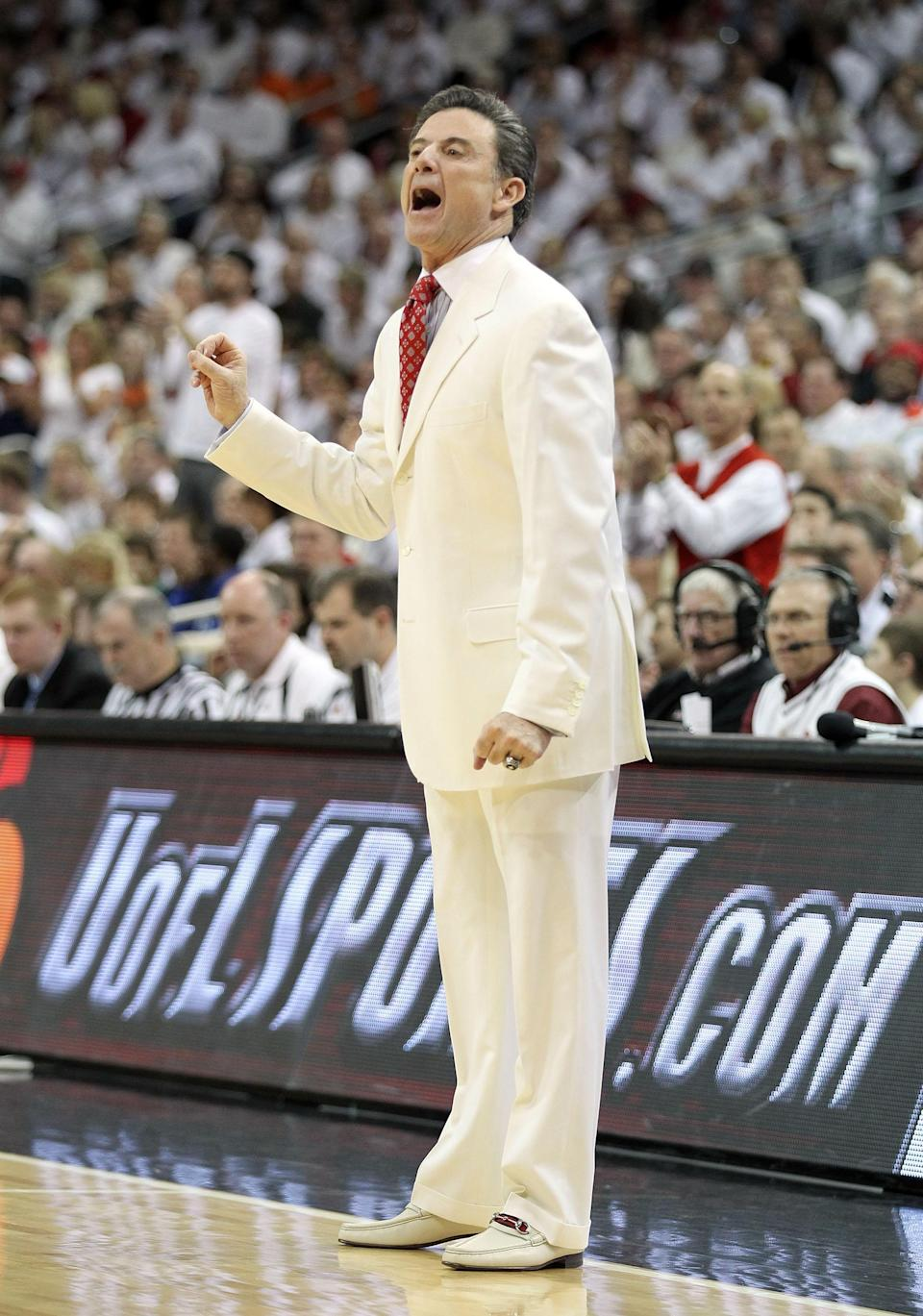 LOUISVILLE, KY - FEBRUARY 13: Rick Pitino the head coach of the Louisville Cardinals gives instructions to his team during the Big East Conference game against the Syracuse Orange at KFC YUM! Center on February 13, 2012 in Louisville, Kentucky. (Photo by Andy Lyons/Getty Images)