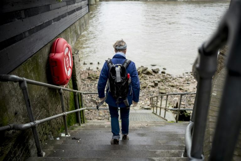 Mudlarks must get a licence from the Port of London Authority, with around 1,500 people allowed to take part at any one time (AFP Photo/TOLGA AKMEN)