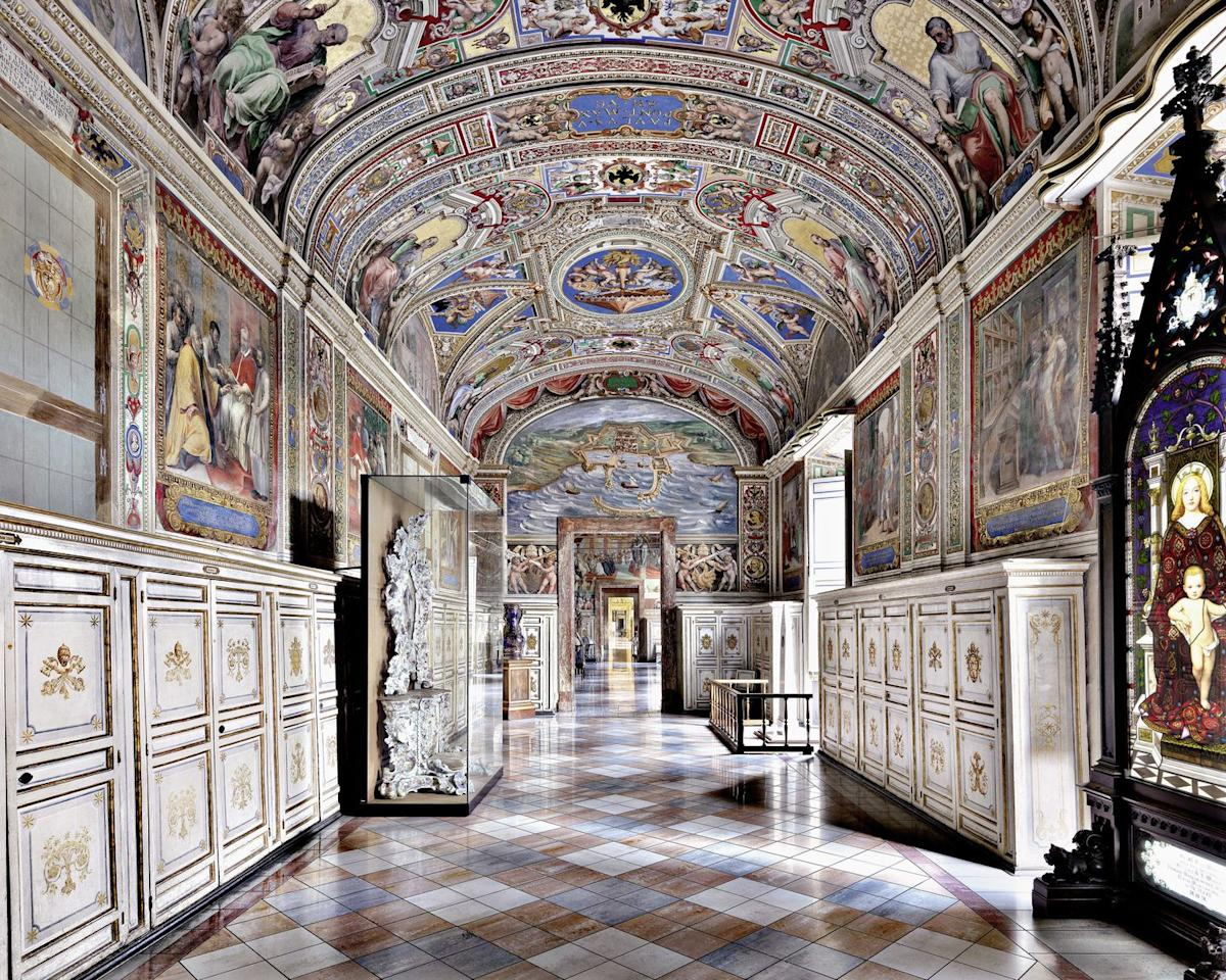 <p>The Vatican Library dates back to Sixtus V (1521–1590), who called for the construction of a new building for its collection of 20,000 volumes. Bramante's Cortile del Belvedere-a location at the center of the Vatican complex that was reserved by Renaissance popes for tournaments and festivities-was selected as the site.</p><p></p>