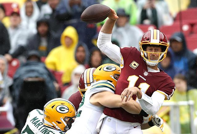 <p>Clay Matthews #52 of the Green Bay Packers hits quarterback Alex Smith #11 of the Washington Redskins in the first half at FedExField on September 23, 2018 in Landover, Maryland. (Photo by Rob Carr/Getty Images) </p>