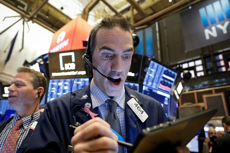 Traders work on the floor at the New York Stock Exchange (NYSE) in New York, U.S., February 28, 2020. REUTERS/Brendan McDermid