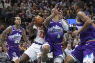 New York Knicks guard Damyean Dotson (21) is fouled by Utah Jazz guard Rayjon Tucker (6) while shooting during the second quarter of an NBA basketball game Wednesday, Jan. 8, 2020, in Salt Lake City. (AP Photo/Chris Nicoll)